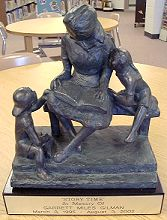 Statue depicting story time in Norwich Community Library- photo by Susan Howell, used by permission